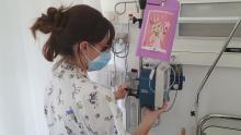 Una infermera posant una Superbox